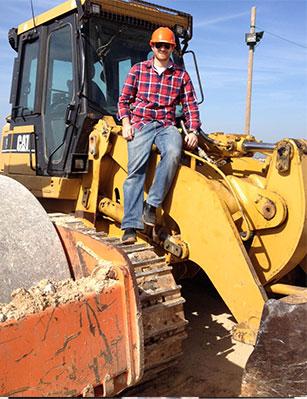 Gabi on a tractor
