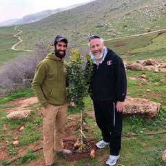 """The """"Zo Artzeinu / Israel Trees"""" project of AYC planted over 20,000 new fruit trees on Tu B'Shvat. This is our farmer, Moshe Sharvit"""