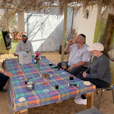 Drinking wine in Be'er Milca, just 800 meters from the Egyptian border! The farmer is Gal Tushiya (middle of the picture) and everything he grows is 100% organic. His wine - Rose, Cabernet Savignon and Port was incredible!!