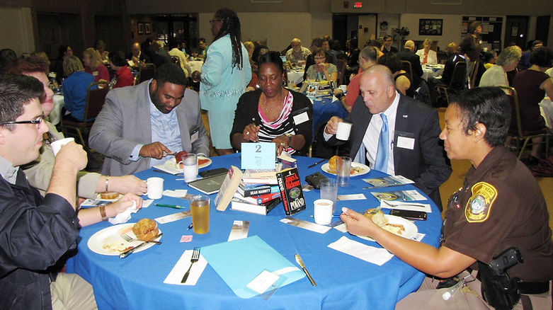 Many tables at breakfast event