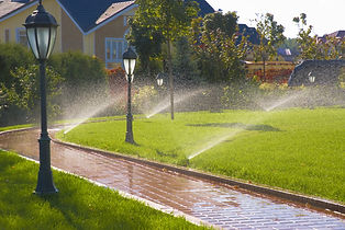 Sprinklers by a house