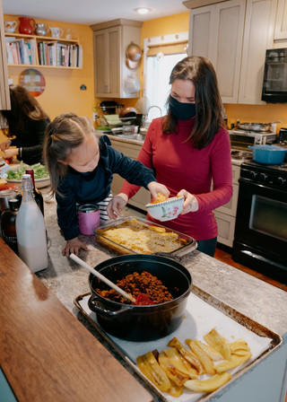 KATY KENNEDY RIVERA GETS DINNER PREP HELP FROM HER DAUGHTERS, DIVI, 13, AND OLIVIA, 3.