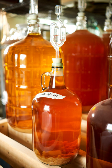 Cider-filled glass carboys at Portersfield Cider in Pownal