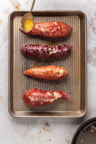 Hasselback sweet potatoes with garlic thyme butter