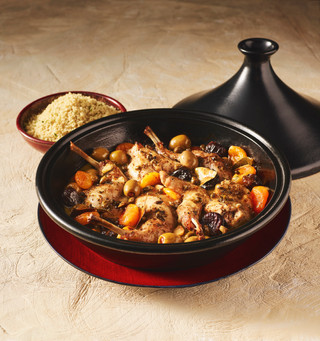 Rabbit tagine with olives, dried fruit, and Mediterranean herbs