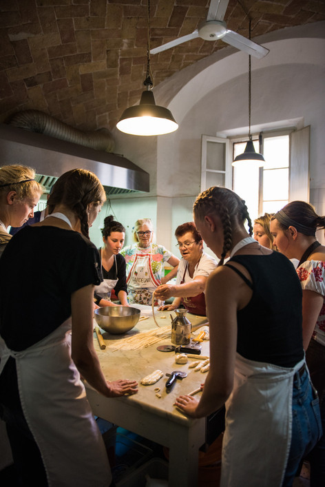 Loredana, a staple at Spannocchia, teaches the  farm's Interns how to make Pici, a hand-rolled pasta  typical of the Siena region
