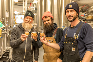 Brewers at Tributary Brewing Company  taste one of their brews to check its development  and reckon it has about a week to go