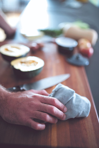 The hands of Chef Barton Seaver begin to prepare some acorn squash