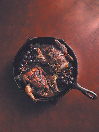 Cocoa-Rubbed Game Hens with Blistered Concord Grapes