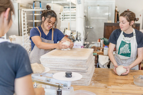 Night Moves staff forms their country sourdough loaves at building 10 in Biddeford's Pepperell Mill Campus.