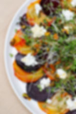 Golden and Ruby Beets with Goat Cheese, Pistachios, and Microgreens