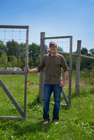 Ciderman David Buchanan at the gate of his orchard