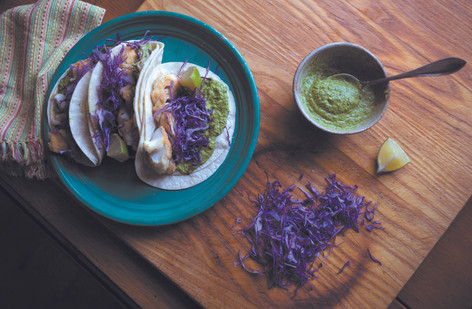 Cilantro corn pesto gives these fish tacos a bright bookst of flavor