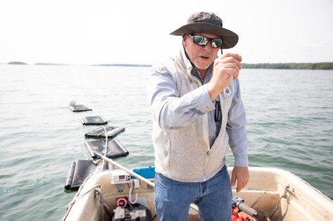 Dan Devereaux, Brunswick's coastal resource manager, makes a point about the potential of farming quahogs in Maquoit Bay.