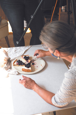 Kelty styles a blueberry tart for a photo set to appear in an upcoming issue of Yankee Magazine.