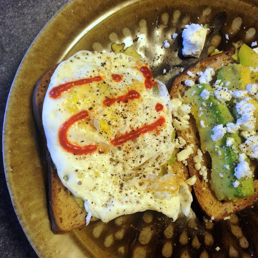 Avocado toast and avocado smash with egg and feta