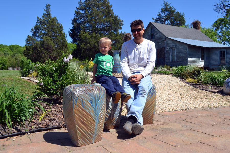 Joseph Sand with son on garden seats