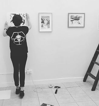 Roxanne hanging artwork for Limb to Limb Group Show 2017