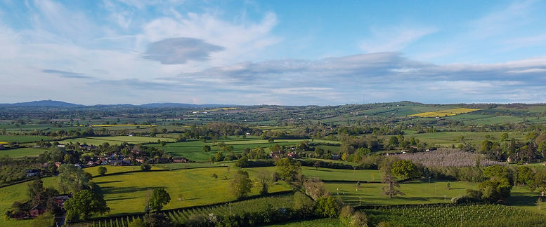 Beautiful rolling Herefordshire countryside with May Hill and Marcle Ridge visible on the horizon