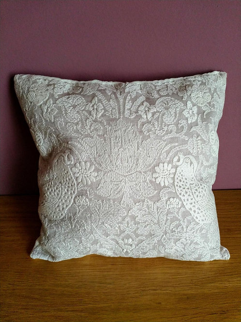 Handmade small cushion in 'Strawberry Thief' white lace fabric