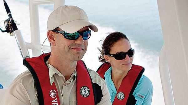 Man and woman enjoying safe boating