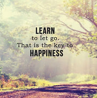 Inspirational life quote with phrase _ learn to let go, that is the key to happiness_ with blur sunb