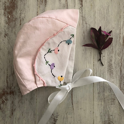 Pink embroidered bonnet
