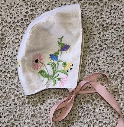 Embroidered linen bonnet