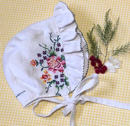 Embroidered frilled bonnet
