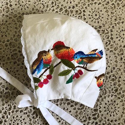Embroidered bird bonnet
