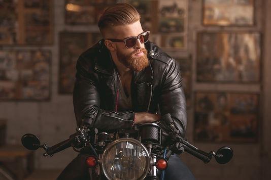 handsome-bearded-man-leather-jacket-sun-
