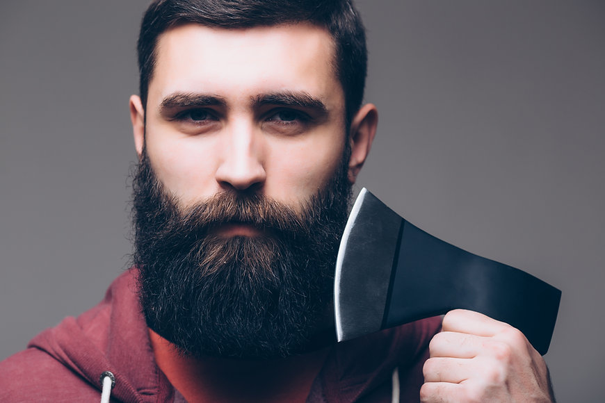 bearded-man-with-axe-cut-hair-with-ax-ma