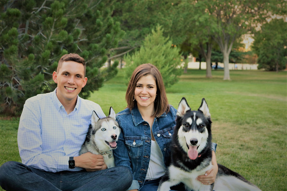 Ryan Chavez with husband, Charles and their huskies.