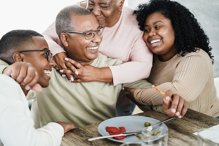 happy-black-family-eating-lunch-at-home-QL2R6BF.jpg
