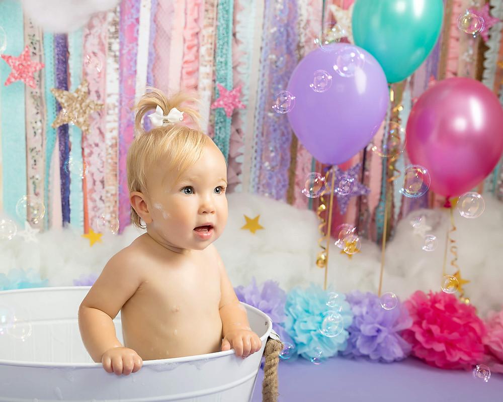 cake smash photo shoot sheffield rotherham baby watching bubbles