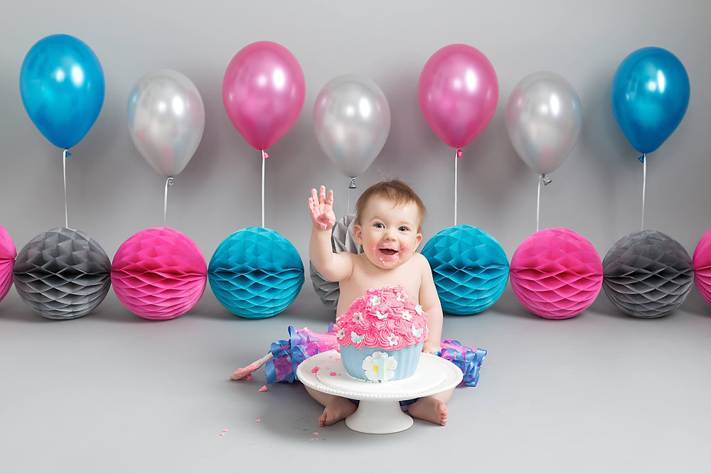Having fun at her Cake Smash Photo shoot Petite Portraits Sheffield Rotherham Worksop