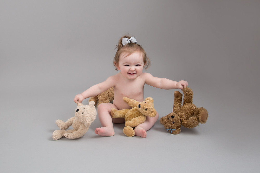 Teddy cuddles at her cake smash session at Petite Portraits Photography Sheffield