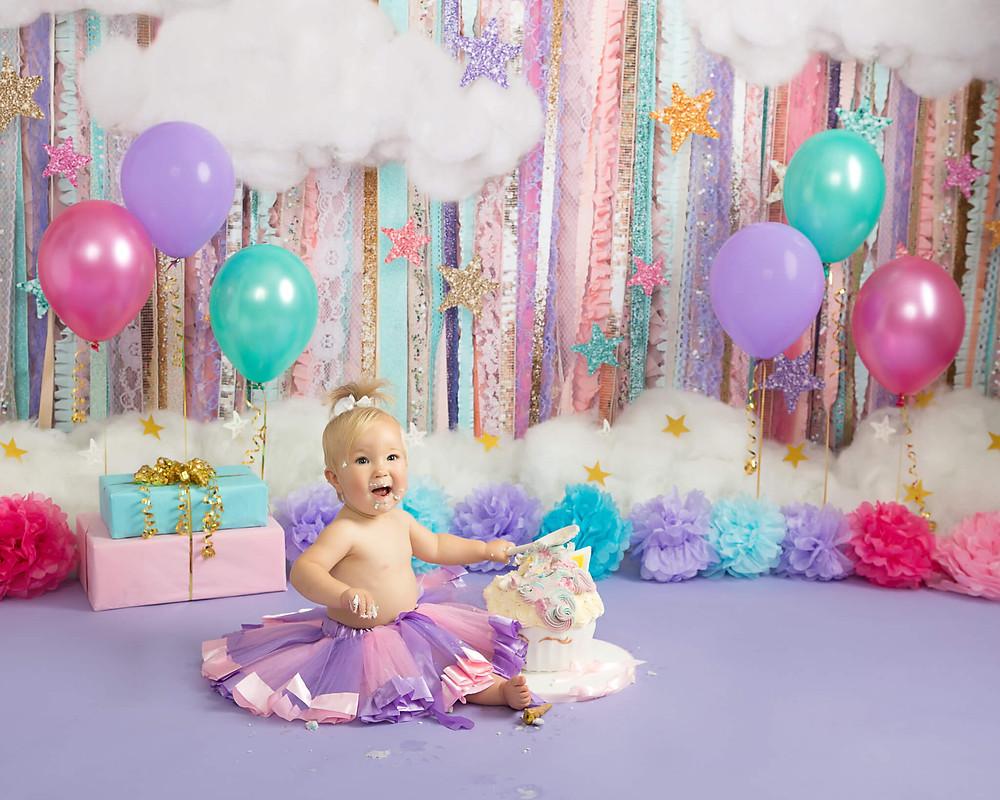 petite portraits cake smash sheffield baby smashing unicorn cake