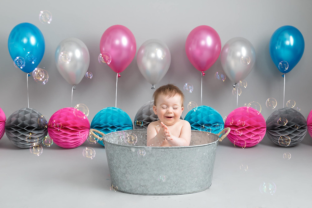 Popping Bath time bubbles at Petite portraits cake smash photo shoot sheffield rotherham worksop aston