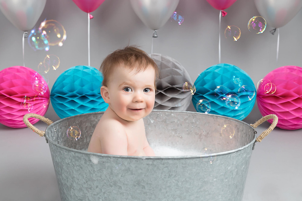 Happy bath time after a cake smash photo shoot at Petite Portraits Sheffield Rotherham Worksop Aston