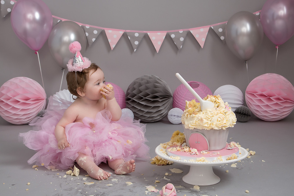 Eating her birthday cake at her Cake Smash photoshoot at Petite Portraits Photography Sheffield
