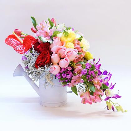 Regadera flores mixtas