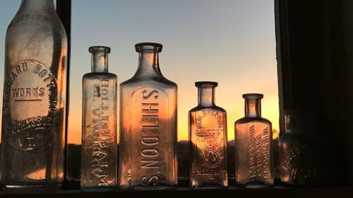 We began attending tag sales and estate auctions with some regularity, buying inexpensive antiques as decoration for our dorm rooms.   The first bottle we ever bought is on the left and we still have it today.
