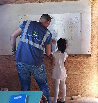 teaching little girl.jpg