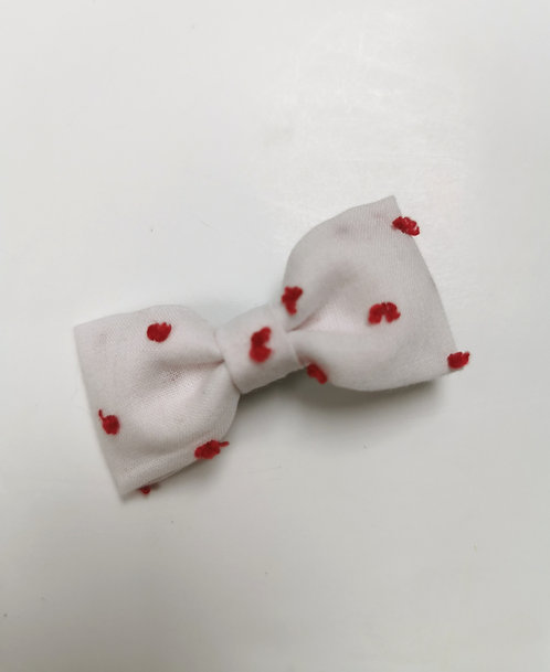 Barrette plumetis rouge fond blanc