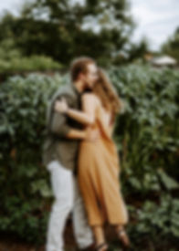 couple engaged in a vineyard at furman university