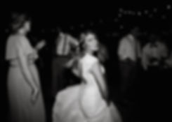 bride dances with flowing dress in black and white