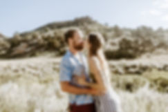 couple kissing in a field in colorado