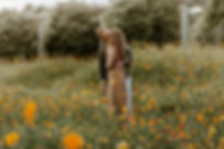 boy and girl kissing in wildflowers