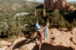 couple dances on red rocks in colorado
